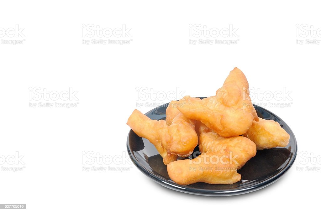 Chinese deep fried dough stick in black plate stock photo
