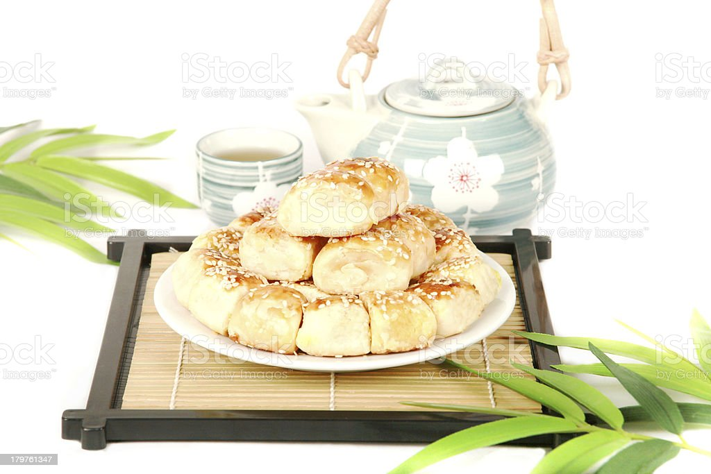 Chinese delicious dessert and tea pot. royalty-free stock photo