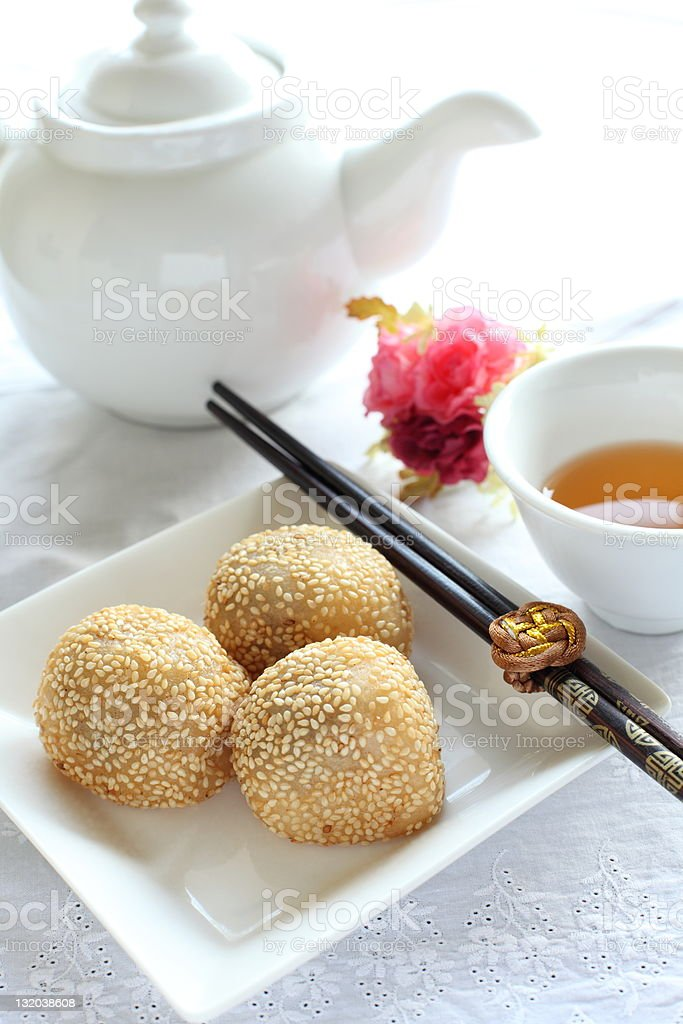 Chinese dim sum, sesame ball  with tea royalty-free stock photo