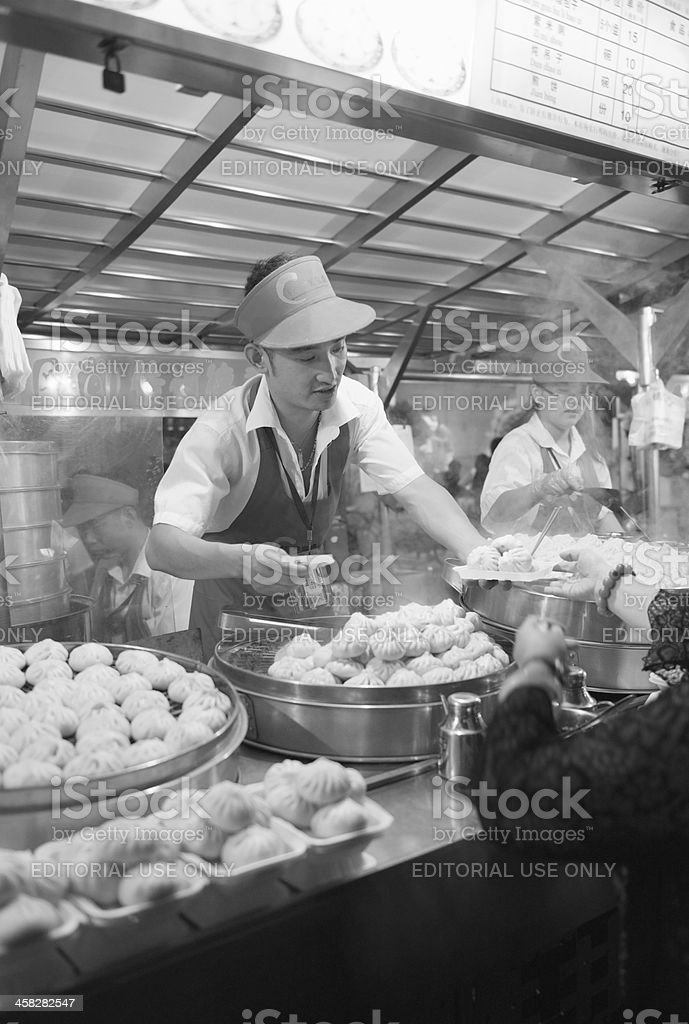 Chinese dim-sum dumplings prepared and sold in Beijing snack street royalty-free stock photo
