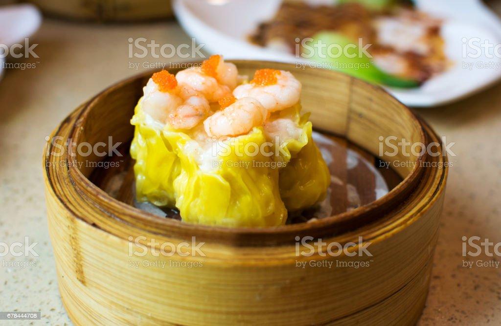 Chinese dimsum shrimp shao mai in bamboo steamer stock photo