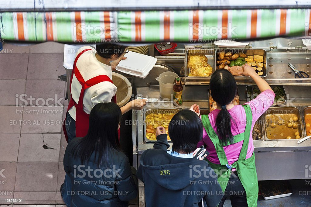 Chinese diners ordering from fast food stall Hong Kong royalty-free stock photo