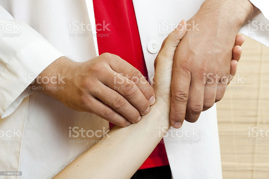 Chinese doctor checking the pulse of a patient royalty-free stock photo