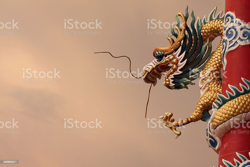 Chinese dragon architectural feature against cloudy sky royalty-free stock photo