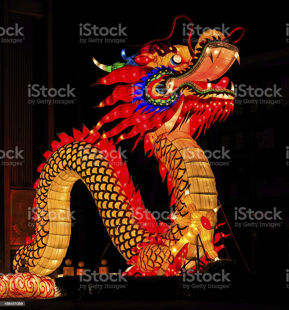 Chinese dragon illuminated in the night stock photo