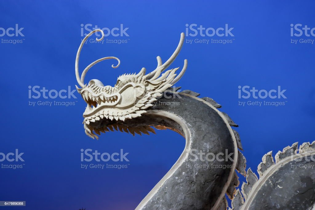 Chinese dragon on blue sky after sunset stock photo