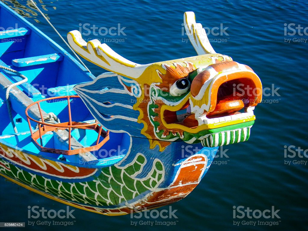 Chinese Dragon Painted Carved Wooden Boat stock photo