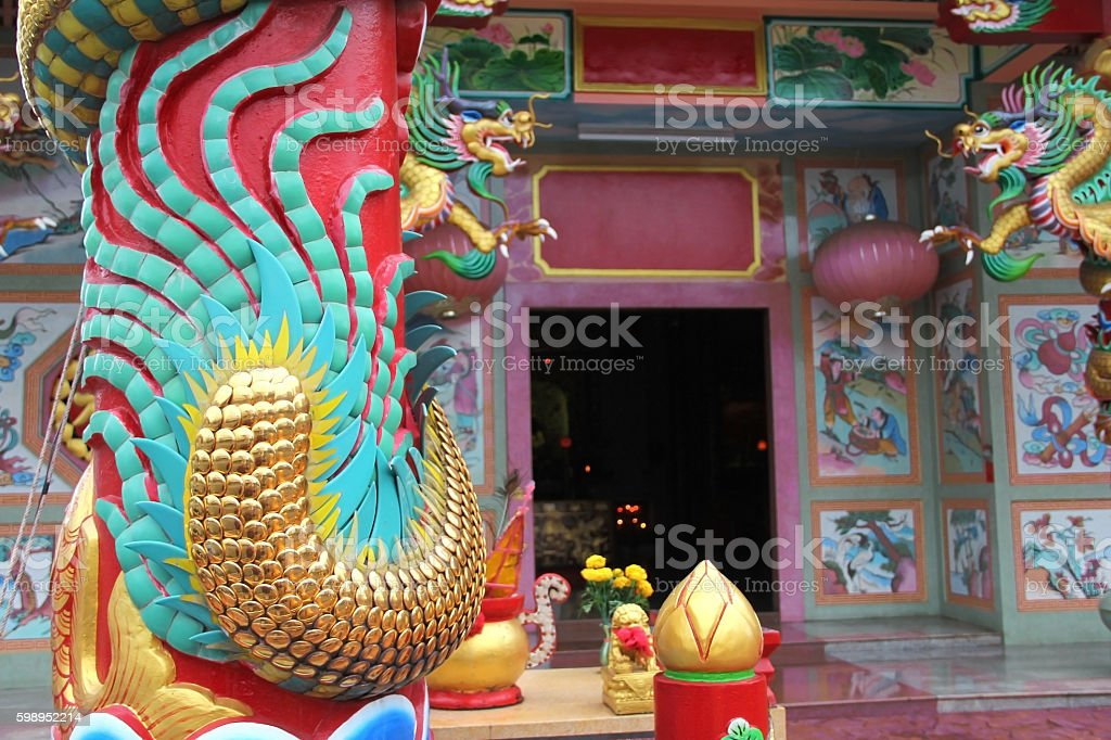 Chinese Dragon'tail sculpture on chinese temple and bokeh background. stock photo