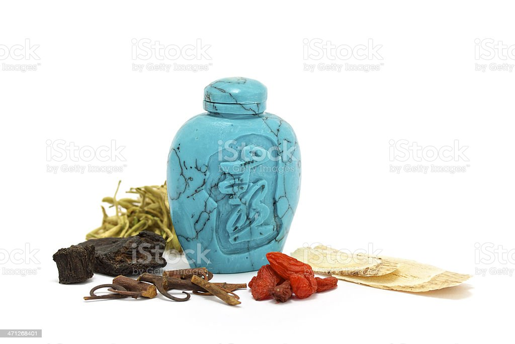Chinese drug bottle and herbs stock photo