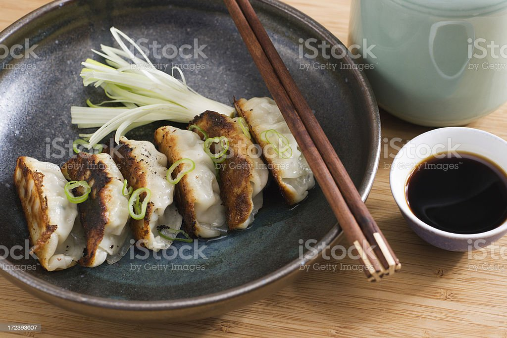 Chinese Dumplings, Asian Fried Potsticker Appetizers Served with Soy Sauce stock photo