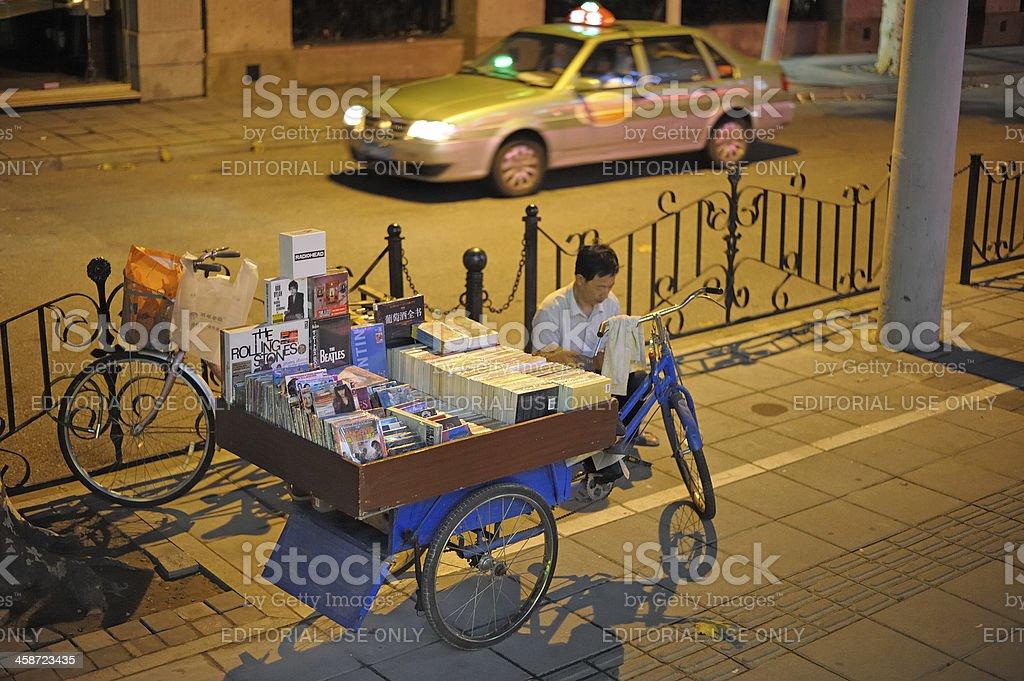 Chinese DVD vendor stock photo