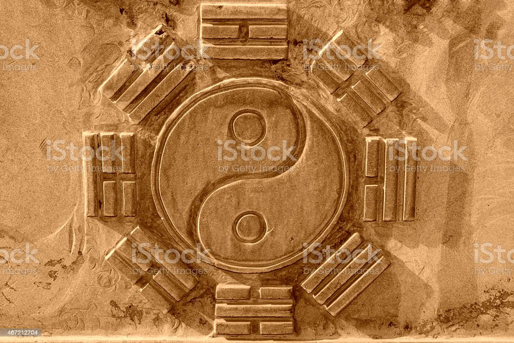 Chinese Eight Trigrams in the gray rock stock photo