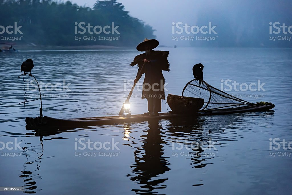 Chinese Fisherman Li River Sunrise Fog stock photo