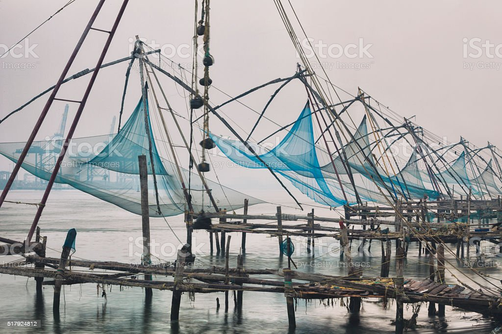 Chinese fishing nets at sunrise in Kochi, India stock photo