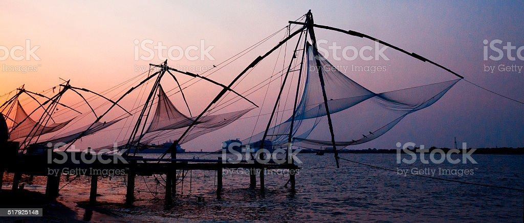 Chinese fishing nets at sunset in Kochi, India stock photo