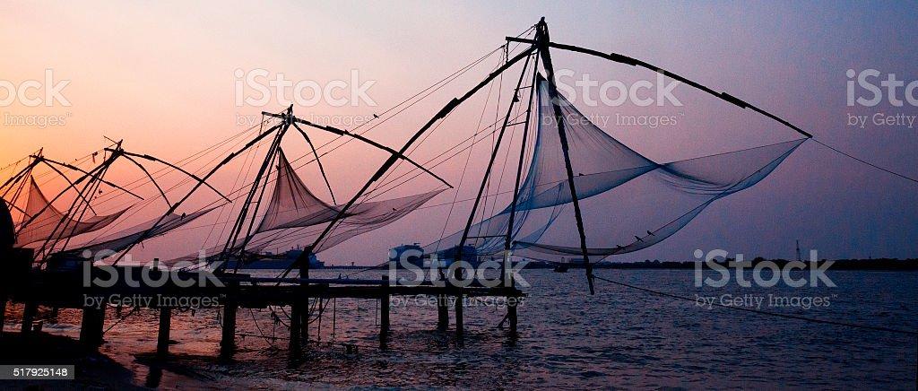 Chinese fishing nets at sunset in Kochi, India stock photo
