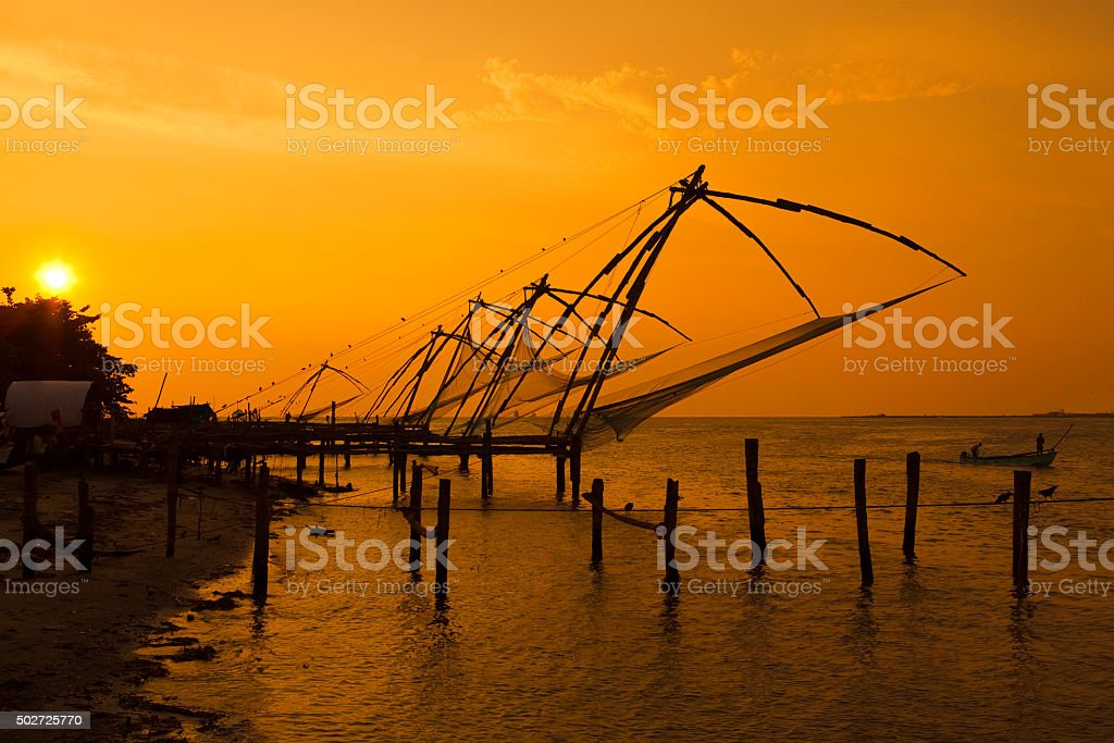 Chinese fishing nets at sunset. stock photo