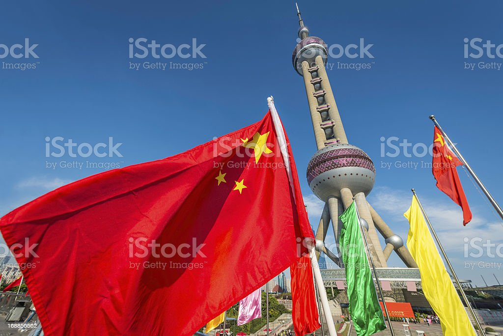 Chinese flag flying in front of Oriental Pearl Tower Shanghai royalty-free stock photo