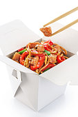 Chinese food. Noodles with fried chicken and vegetables isolated