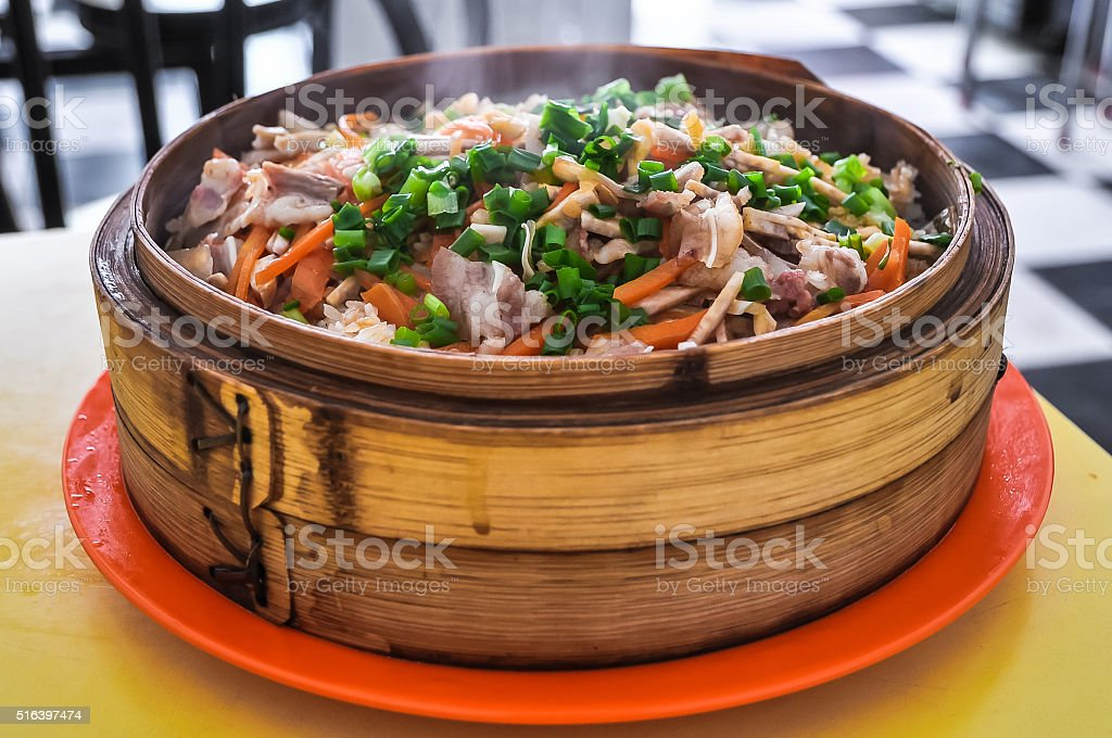 Chinese food - steamed rice with vegetables and meat stock photo