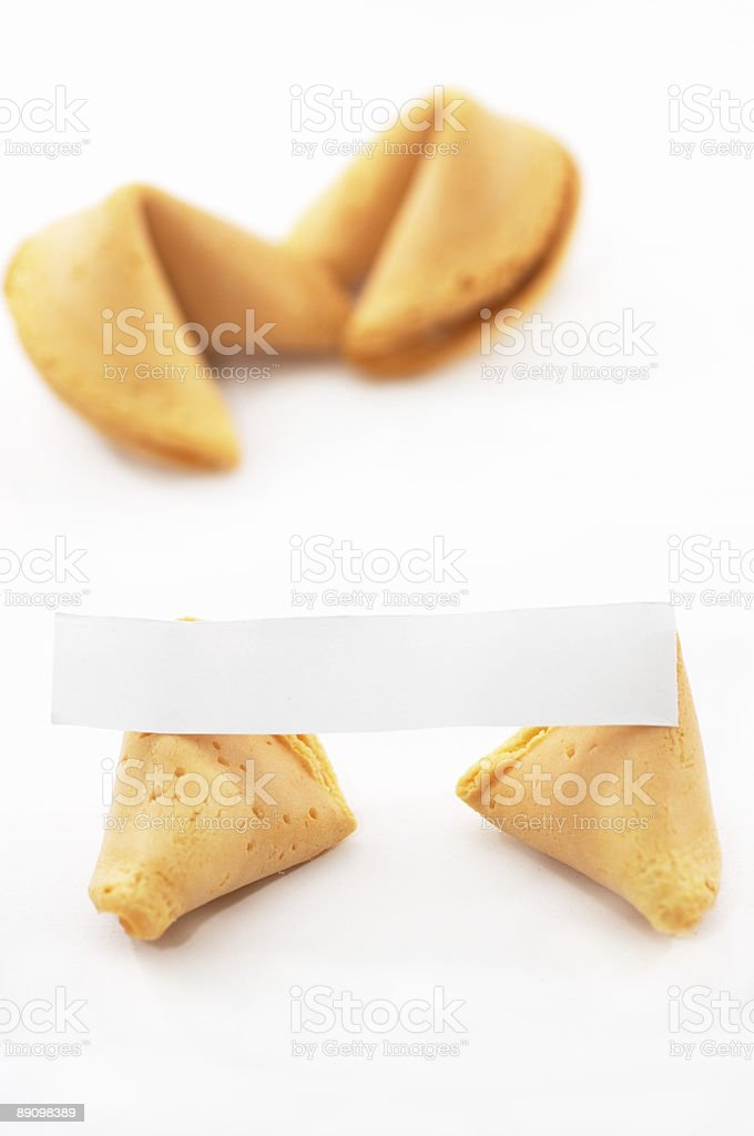 Chinese Fortune Cookie open with blank paper, on white backgrou royalty-free stock photo