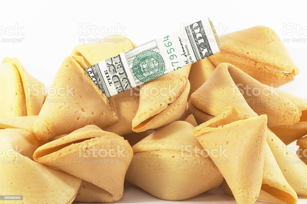 Chinese Fortune Cookie open with money, cash, on white backgrou stock photo