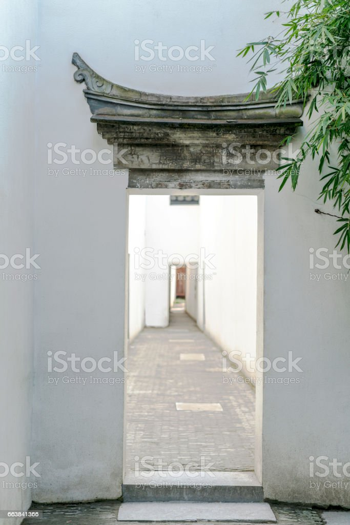 Chinese gateway and aisle in courtyard stock photo