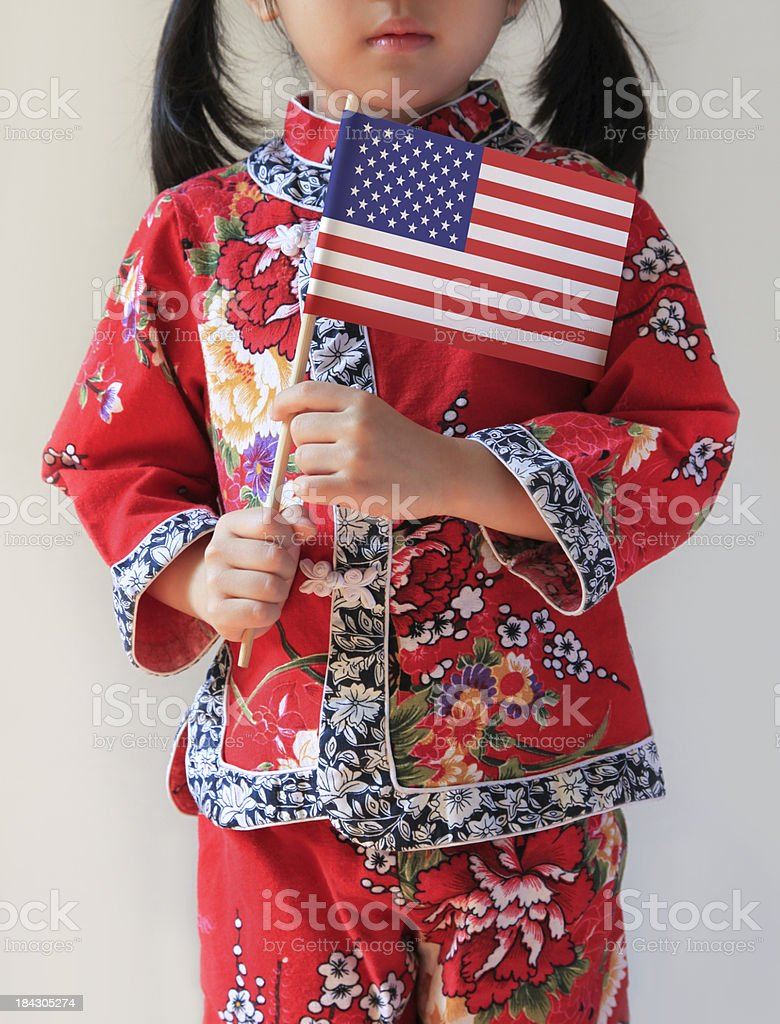 Chinese Girl Holding American Flag stock photo