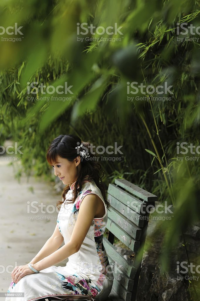 Chinese Girl in traditional cheongsam royalty-free stock photo