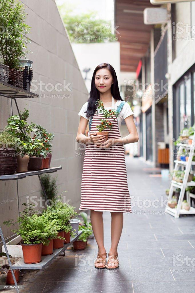 chinese girl wearing an apron stock photo