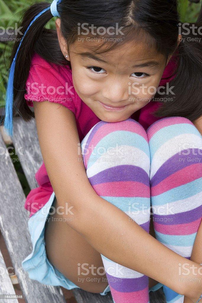 Chinese girl wearing cute, striped socks royalty-free stock photo