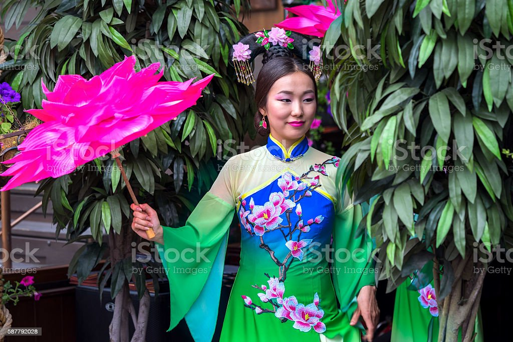 Chinese girl with dress traditional Cheongsam in Garden stock photo