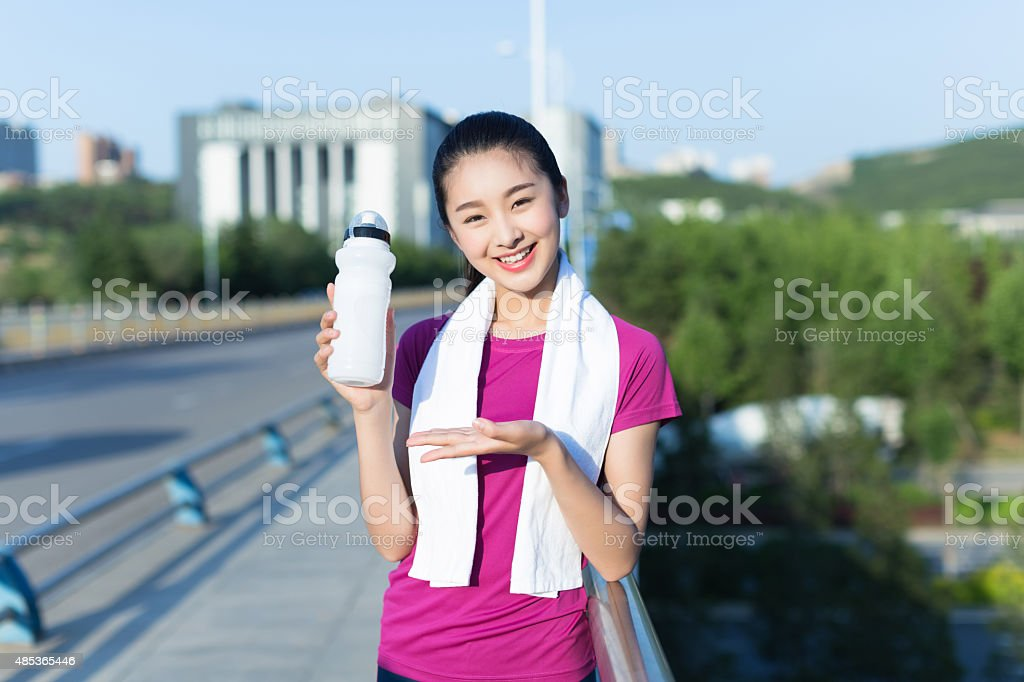 chinese girl with sports bottle stock photo
