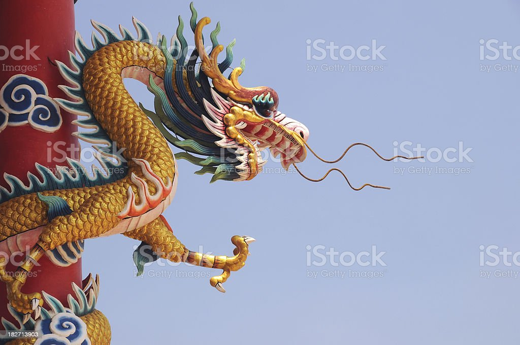 Chinese Gold Dragon and Sky at China Temple royalty-free stock photo