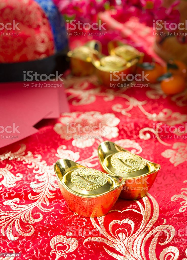 Chinese gold ingot with setups on background stock photo