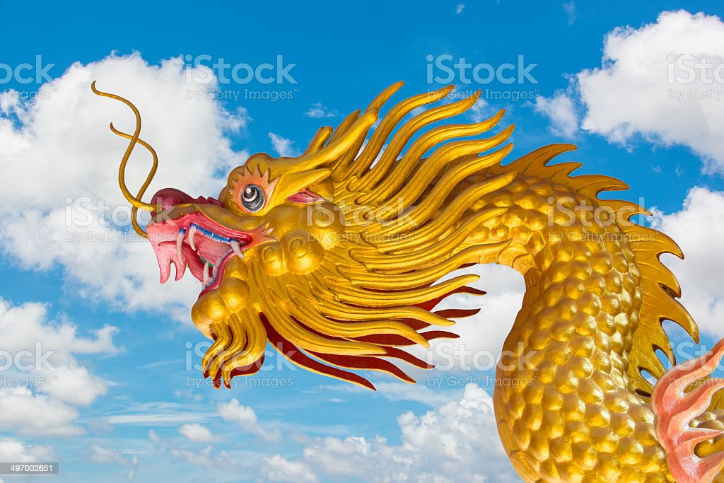 Chinese Golden Dragon and Blue Sky royalty-free stock photo