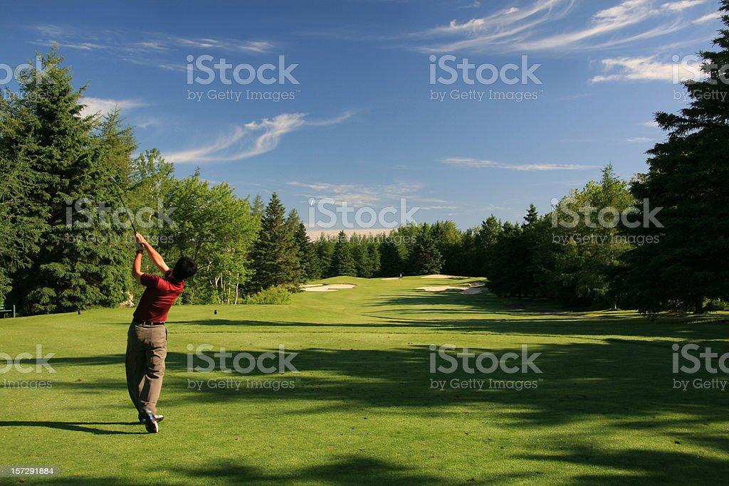 Chinese Golfer Hitting a Tee Shot royalty-free stock photo