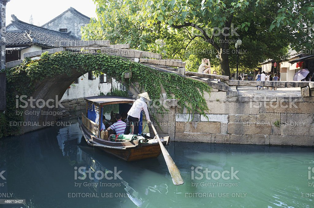 Chinese gondola boat sightseeing trip under Twin Bridges in Zhouzhuang stock photo