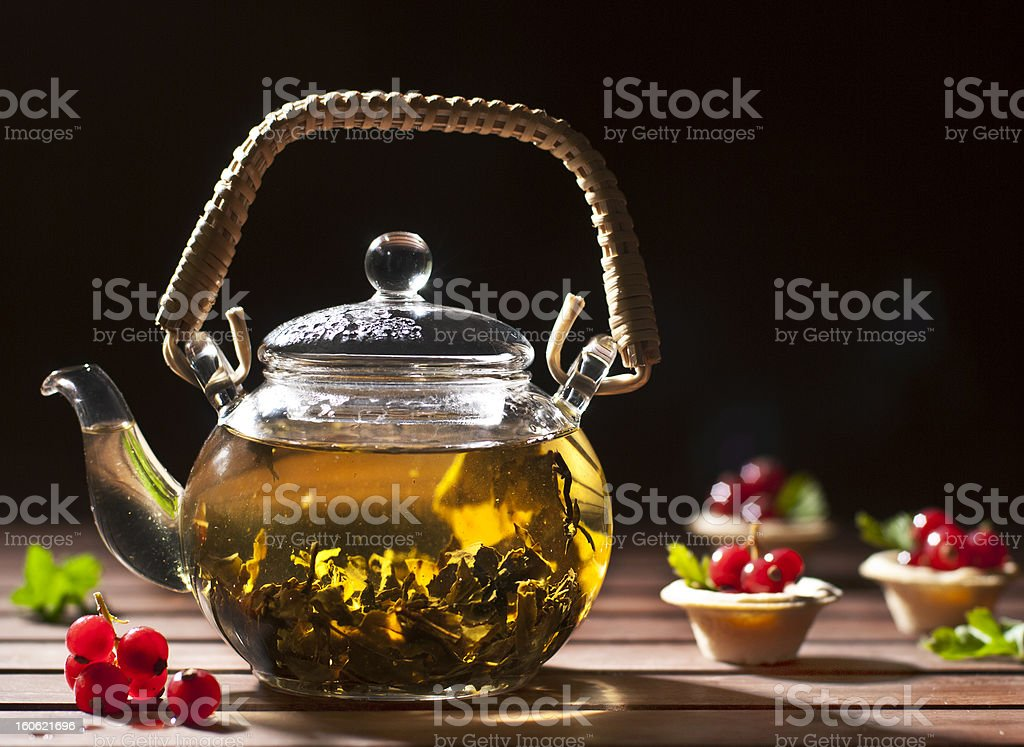 Chinese green tea with red currants tartlets royalty-free stock photo