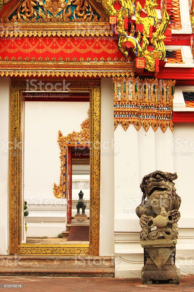 Chinese guardian lion statue at Wat Pho stock photo