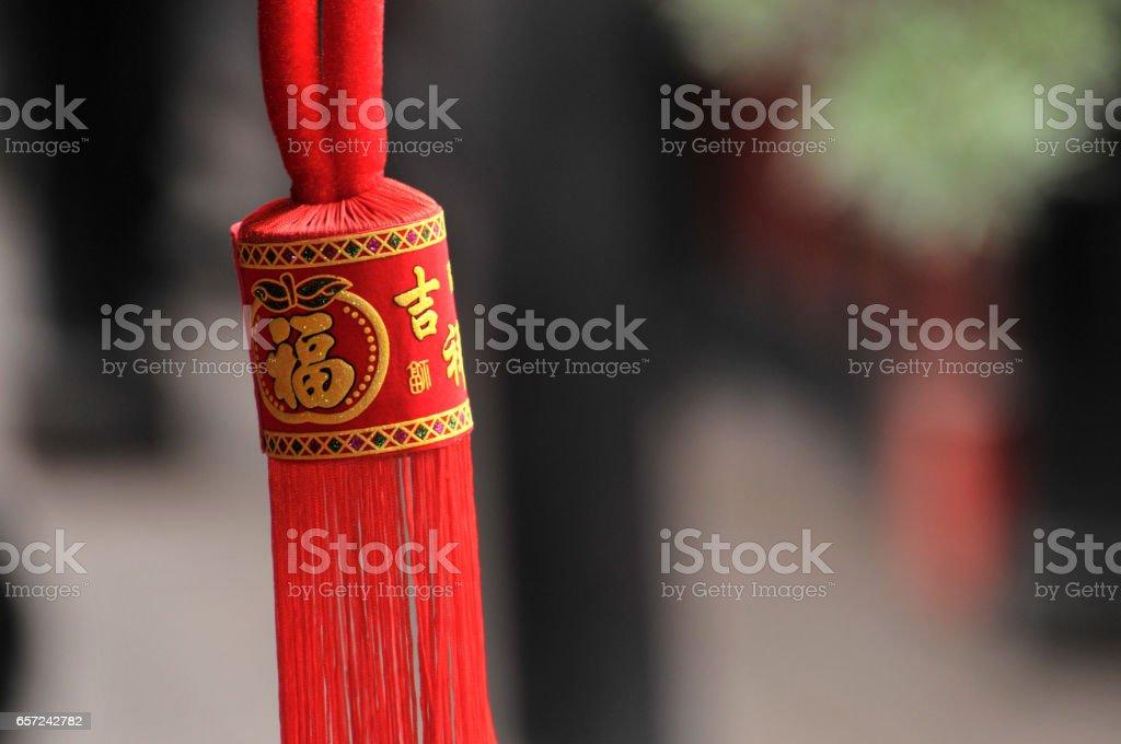 Chinese hanging amulets and lanterns stock photo