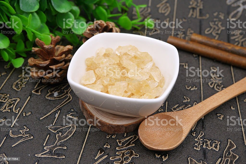 Chinese herbal drugs of resin sugar on the table stock photo