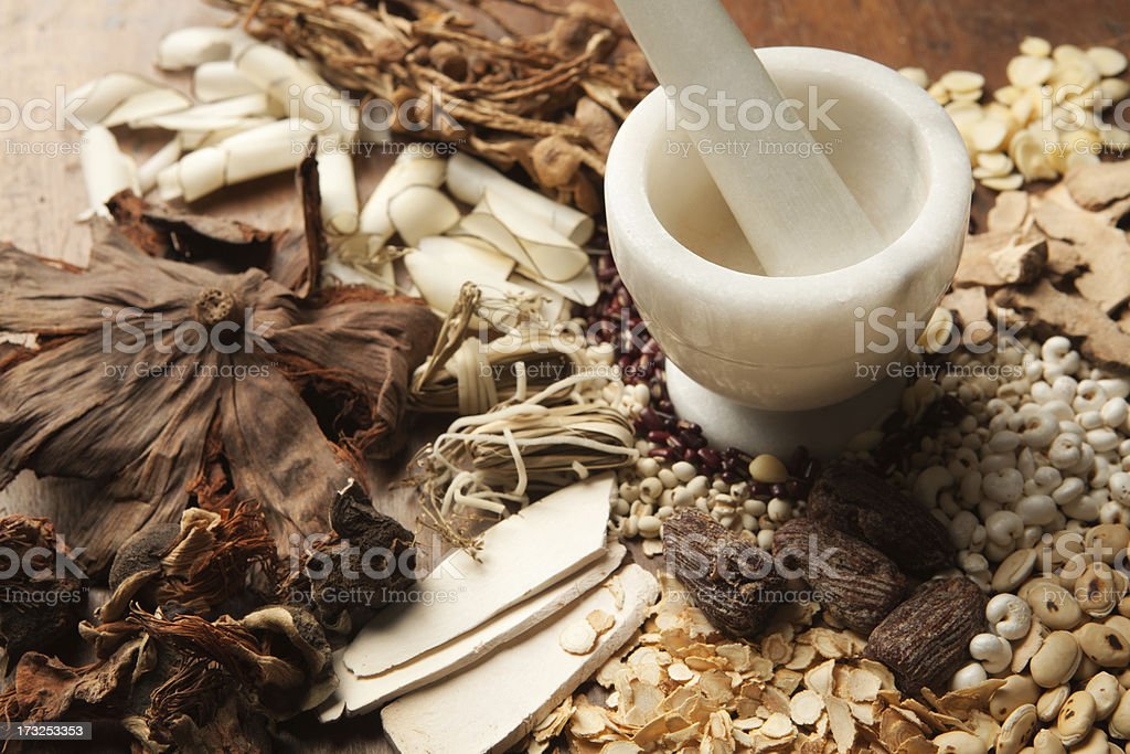 Chinese Herbal Medicine with Mortor and Pestle on Wood Hz stock photo