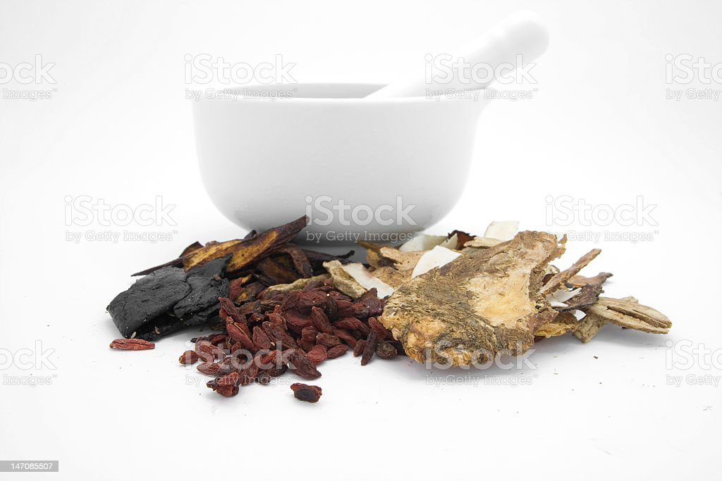 Chinese herbal medicines with a ceramic mortar royalty-free stock photo
