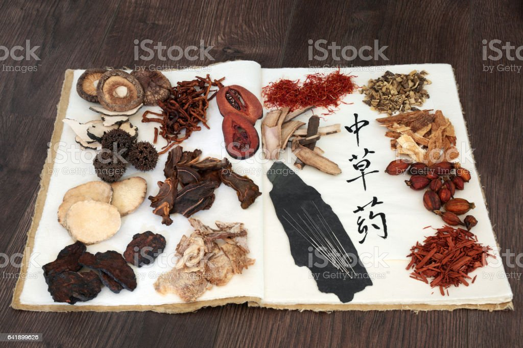Chinese Herbs and Acupuncture Needles stock photo