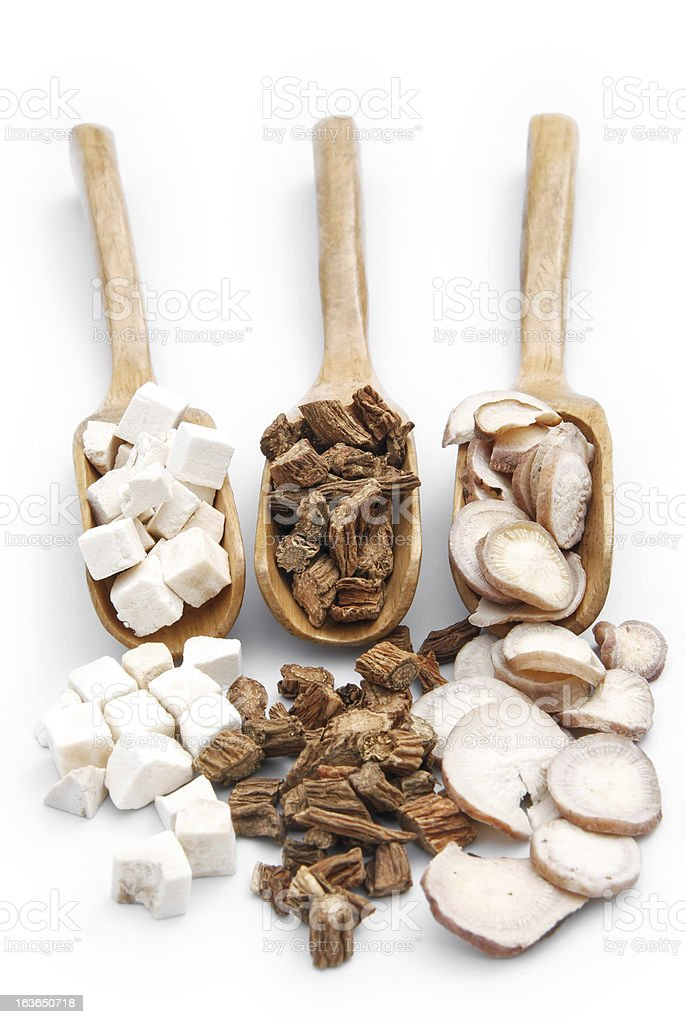 chinese herbs on wooden spoons,vertical royalty-free stock photo