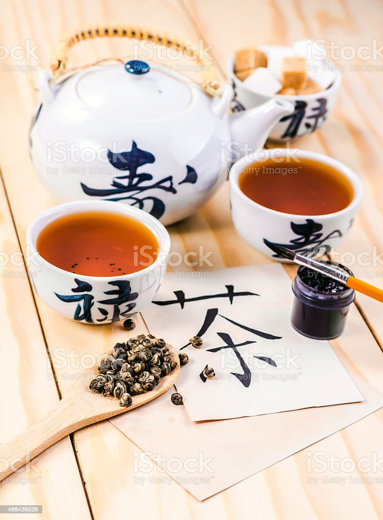 Chinese hieroglyph for 'tea' and set of tea stock photo