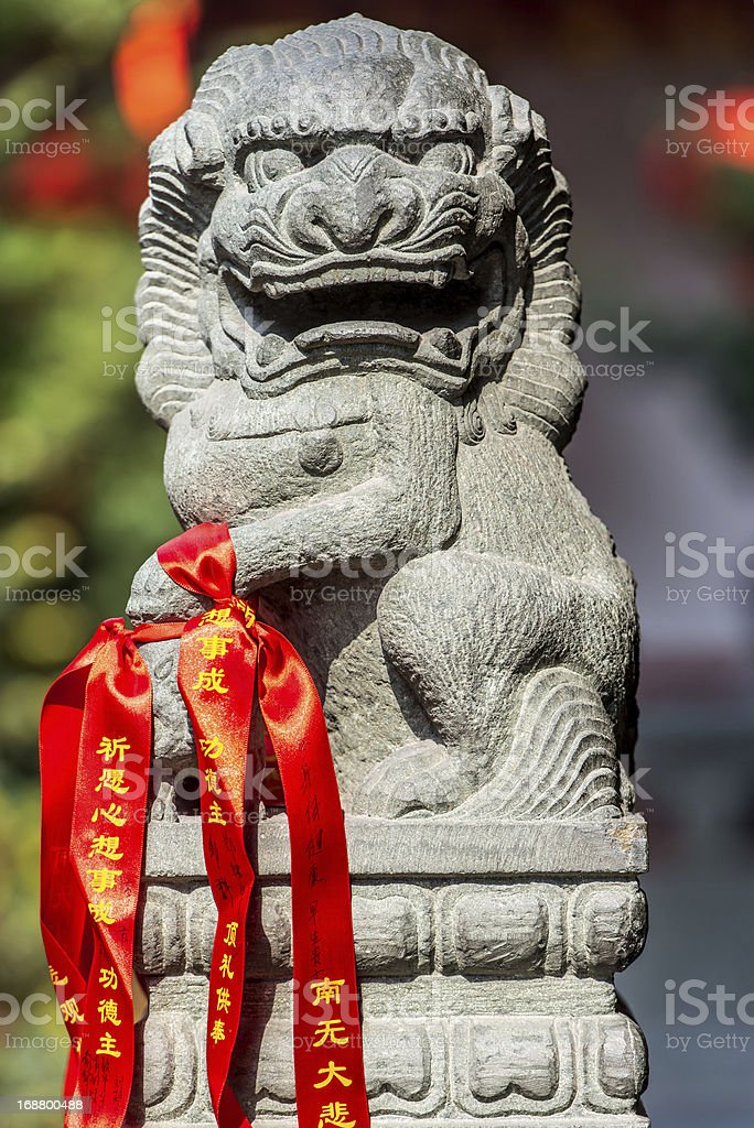 chinese imperial lion statue in The Jade Buddha Temple shang stock photo