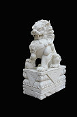Chinese Imperial Lion Statue, Isolated on black background.