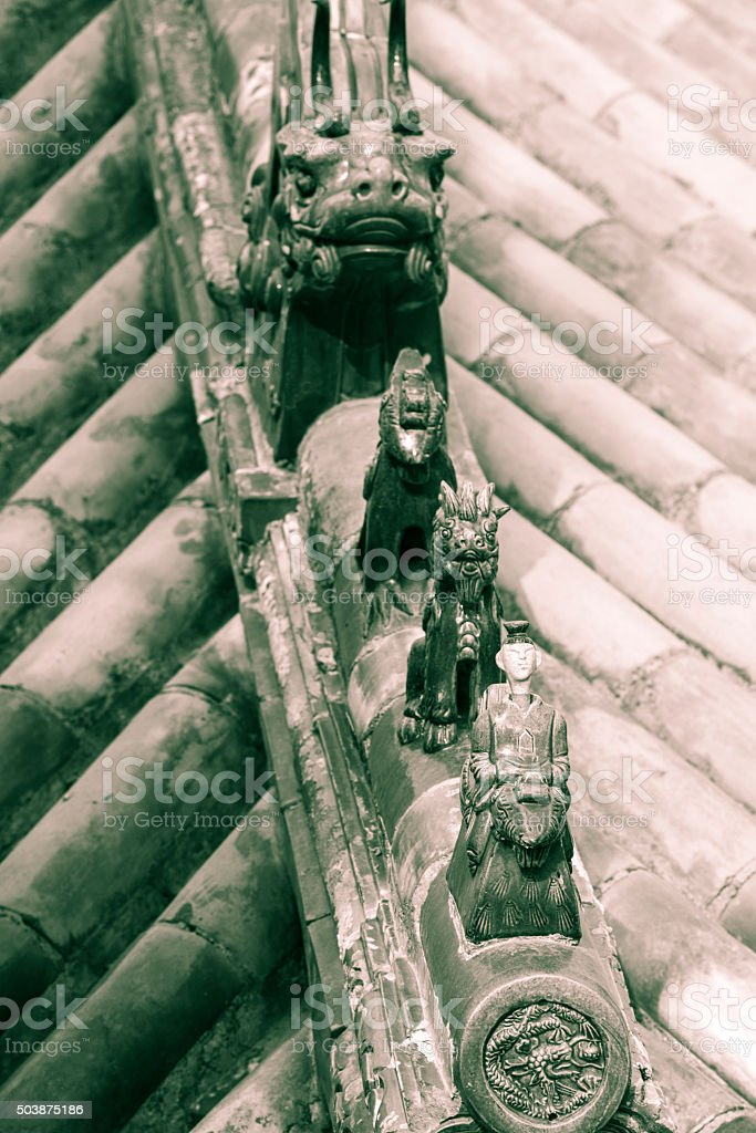 Chinese imperial roof decoration in glazed ceramic stock photo